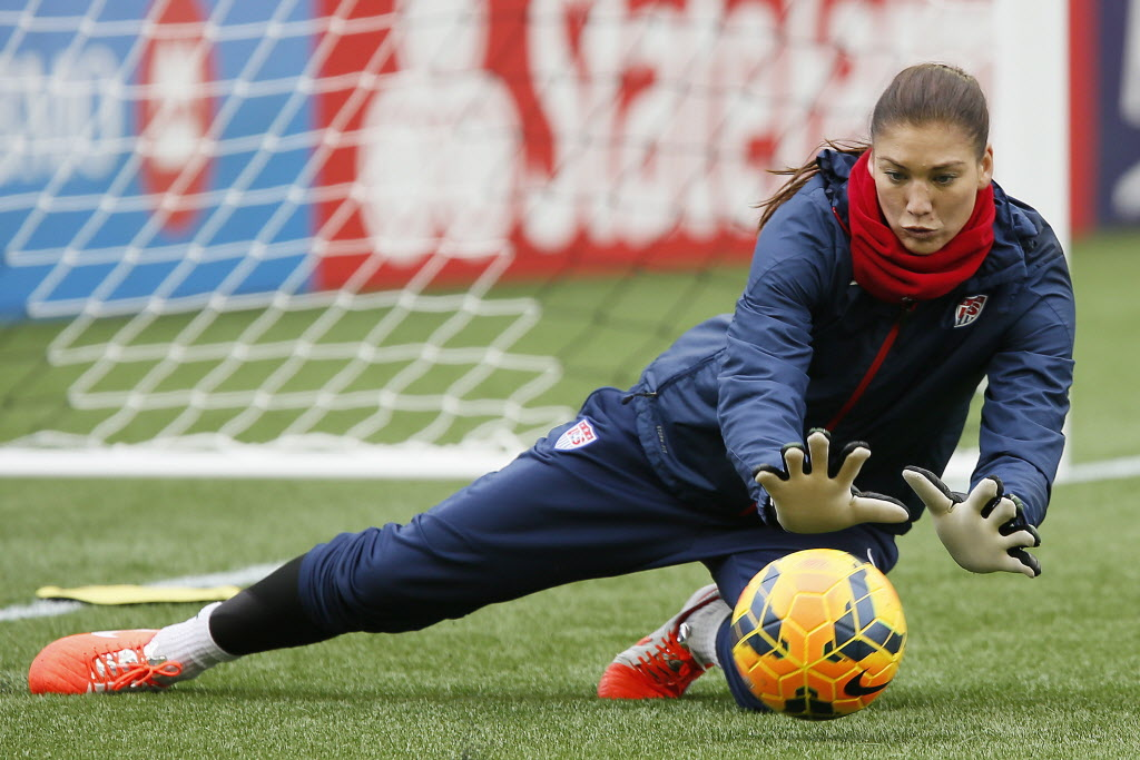 Team USA goalkeeper Hope Solo makes a save at practice in Winnipeg on Wednesday, May 7, 2014. Team USA was practicing in preparation for their friendly match against Canada on Thursday.