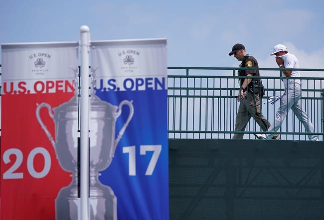 Rickie Fowler walks to the clubhouse after a practice round for the U.S. Open golf tournament Monday