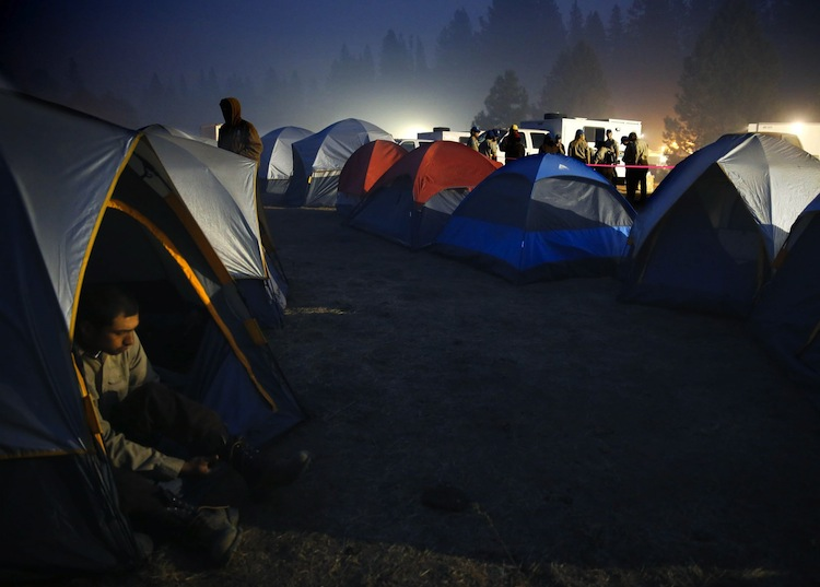 Firefighters wake up at the crack of dawn in a tent camp at the Rim fire base camp near Groveland, Calif., Monday. (Don Bartletti / Los Angeles Times / MCT)