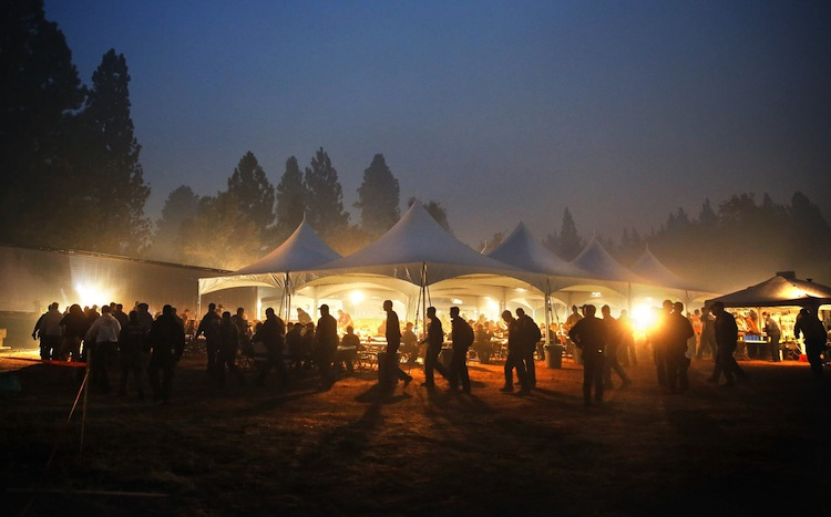 Firefighters line up for breakfast at camp at sunrise. (Don Bartletti / Los Angeles Times / MCT)