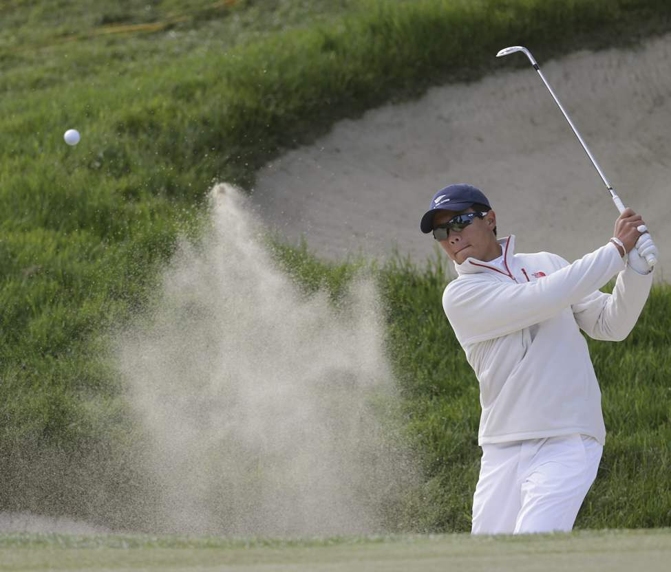 Andy Zhang hits out of a bunker on the second hole during a practice round for the U.S. Open Championship golf tournament Thursday, June 14, 2012, at The Olympic Club in San Francisco.  (Eric Gay / The Associated Press)