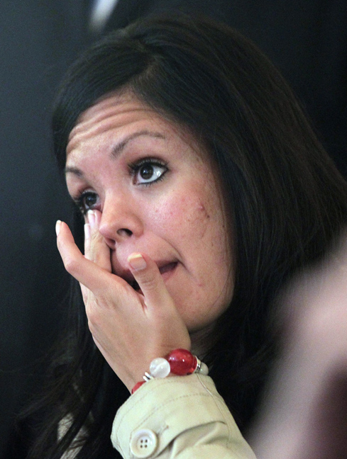 Linda Patino tears up as she watches a television broadcast as Republican presidential candidate and former Massachusetts Gov. Mitt Romney gives his concession speech during a Utah State GOP election night watch party Tuesday, in Salt Lake City.
