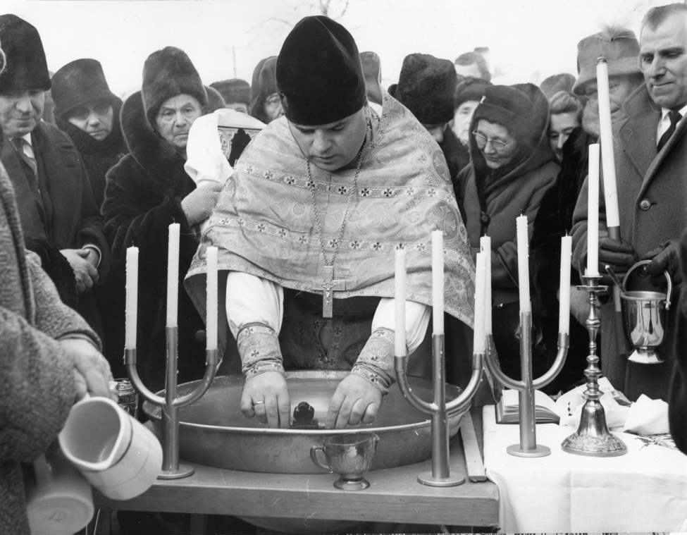 Winnipeg Free Press Archives January 25, 1963 An ancient Ukrainian religious custom was marked last weekend at the Ukrainian Orthodox Cathedral of St. Mary the Protectress, 820 Burrows Avenue. The rector, Rev. Ivan Stus, celebrates the Feast of the Epiphany which, according to the Julian calendar, occurred January 19 in the third century when the birth of Christ was introduced as a Christian holy day. Rev. Stus performs the blessing of the water, commemorating Christ's baptism. The ceremony is performed in all Ukrainian orthodox churches.