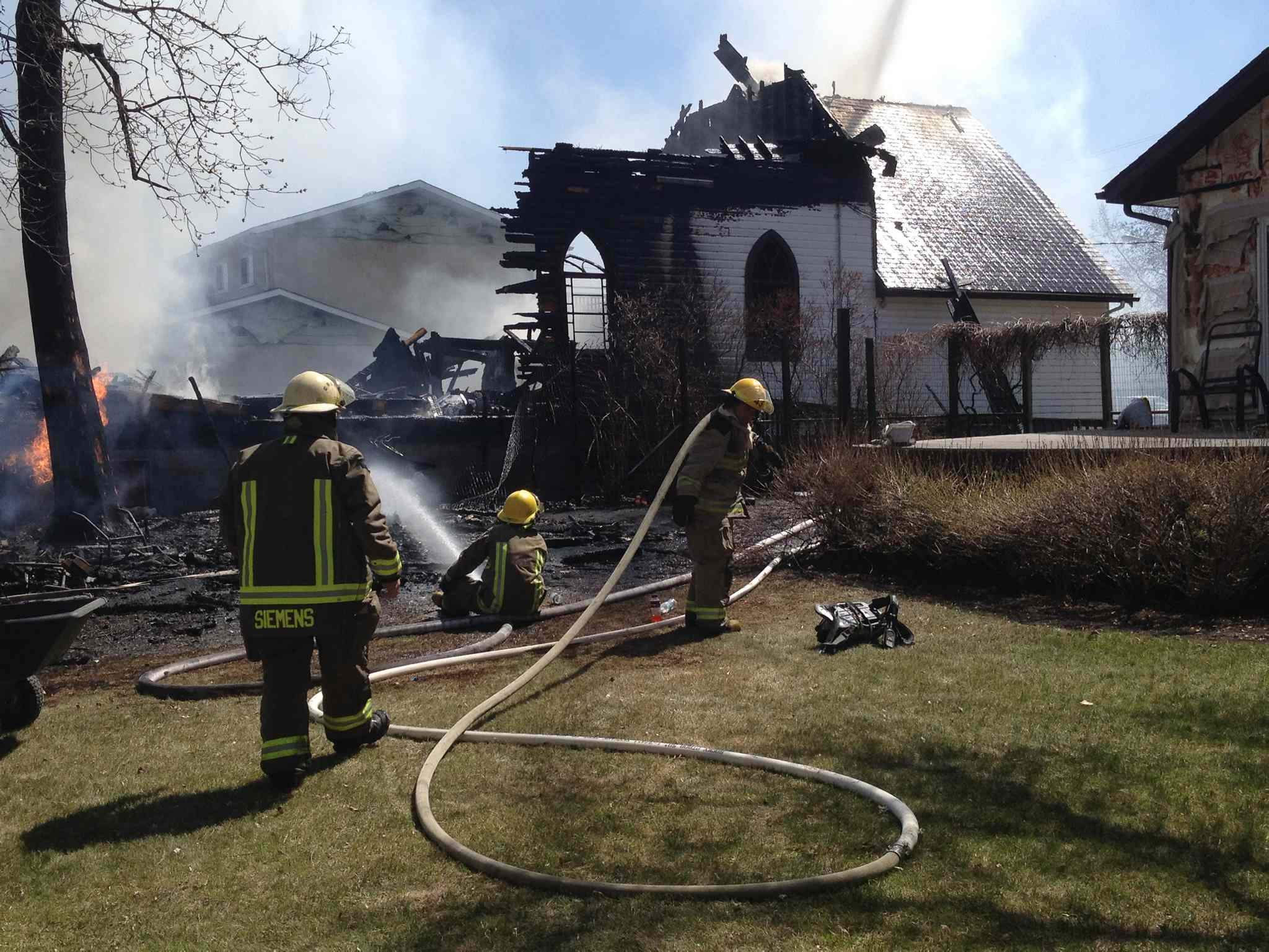 Firefighters douse the flames of the fire that destroyed the 110-year-old United Church in the community of Starbuck this afternoon. The blaze began shortly after lunch, and fire crews from the RM of Macdonald and neighbouring municipalities responded.