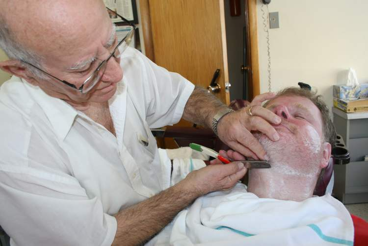Doug Speirs gets a close shave from Pace Santilli.