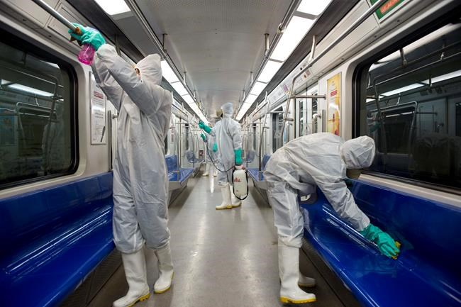 Workers disinfect subway trains against coronavirus in Tehran, Iran, in the early morning of Tuesday, Feb. 25, 2020. Iran's government said Tuesday that more than a dozen people had died nationwide from the new coronavirus, rejecting claims of a much higher death toll of 50 by a lawmaker from the city of Qom that has been at the epicenter of the virus in the country. (Sajjad Safari/IIPA via AP)