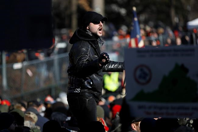 A man speaks during a pro-gun rally, Monday, Jan. 20, 2020, in Richmond, Va. Thousands of pro-gun supporters are expected at the rally to oppose gun control legislation like universal background checks that are being pushed by the newly elected Democratic legislature. (AP Photo/Julio Cortez)