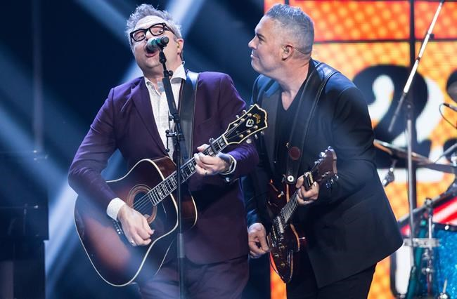 Ed Robertson, right, of the Barenaked Ladies, and former member and co-founder Steven Page, left, perform during the Juno Awards in Vancouver, B.C., on Sunday March 25, 2018. THE CANADIAN PRESS/Darryl Dyck