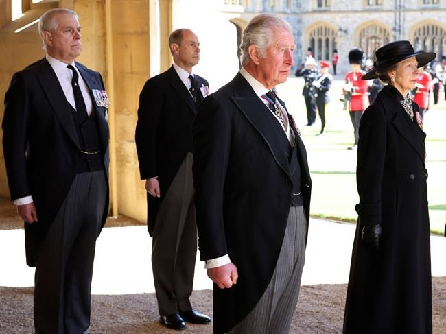 From left, Prince Andrew, Prince Edward, Prince Charles and Princess Anne arrive after walking in a procession behind the coffin of Prince Philip, with other members of the Royal family during the funeral of Britain's Prince Philip inside Windsor Castle in Windsor, England, Saturday, April 17, 2021. Prince Philip died April 9 at the age of 99 after 73 years of marriage to Britain's Queen Elizabeth II. (Chris Jackson/Pool via AP)