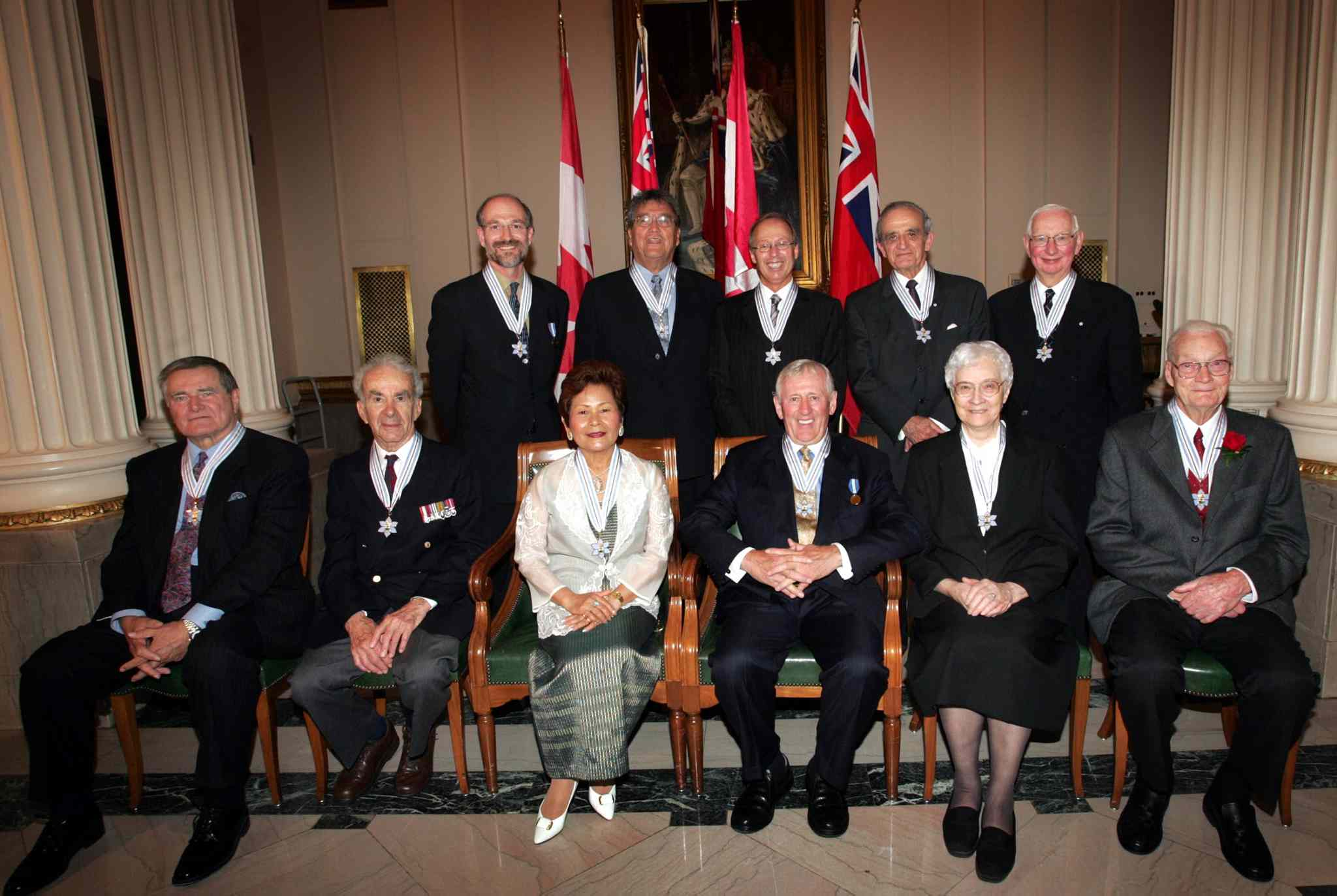 Eleven Manitobans receive the Order of Manitoba during a ceremony in Ottawa on July 15, 2004. Front row, left to right: The Honourable Benjamin Hewak, Val Werier, Virginia Guiang, Leonard Cariou, Sister Theresa Champagne and Vern Hildahl. Back row, left to right: Dr. Harvey Chochinov, Dr. Don Robertson, Samuel Katz, Dr. Arthur Mauro and Dr. Henry Friesen.