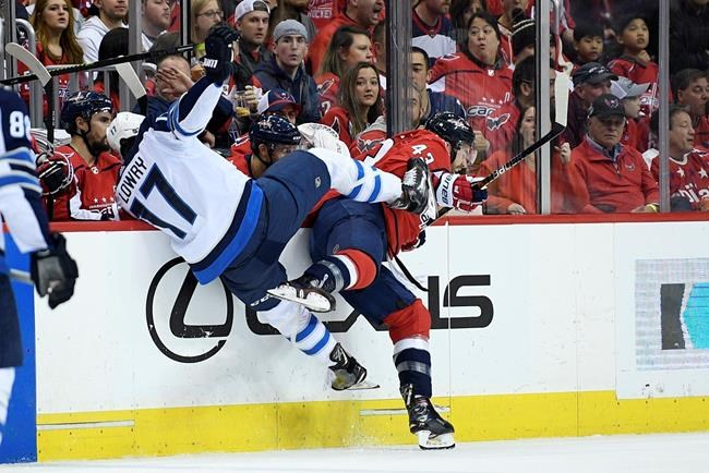Washington Capitals right-winger Tom Wilson (43) and Winnipeg Jets centre Adam Lowry (17) collide.