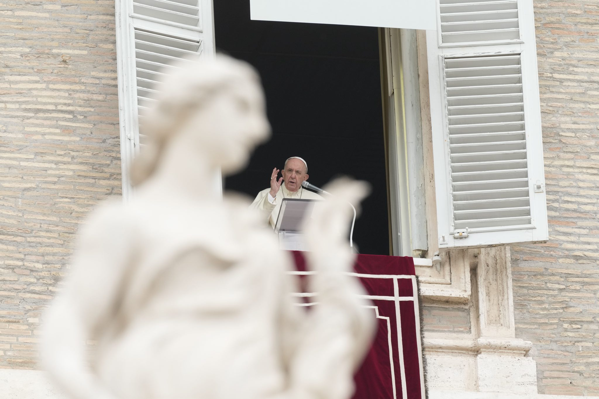 Pope Francis delivers his message during the Angelus noon prayer in St. Peter's Square at the Vatican on Sunday. Canadian bishops have pledged to work with Indigenous people towards arranging a Papal visit.