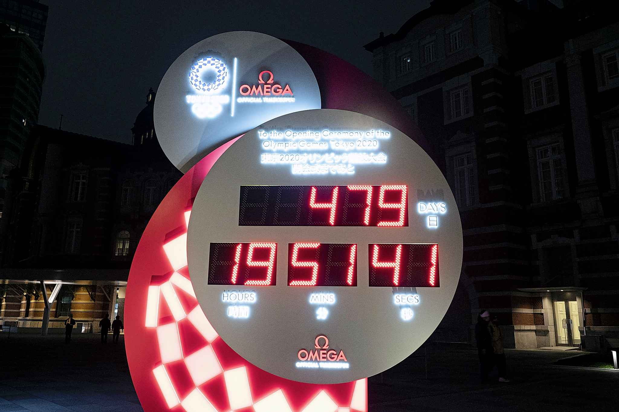 A countdown clock displays the remaining days until the new start date for the Tokyo 2020 Olympics Tuesday. The Tokyo Olympics will open next year in the same time slot scheduled for this year's games. (Jae C. Hong / The Associated Press)