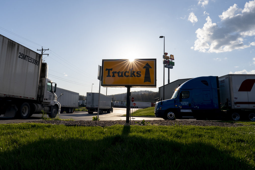 Two of the three latest cases of COVID-19 in Manitoba involved truckers who drove multiple routes through the United States. (Carolyn Kaster / The Associated Press files)