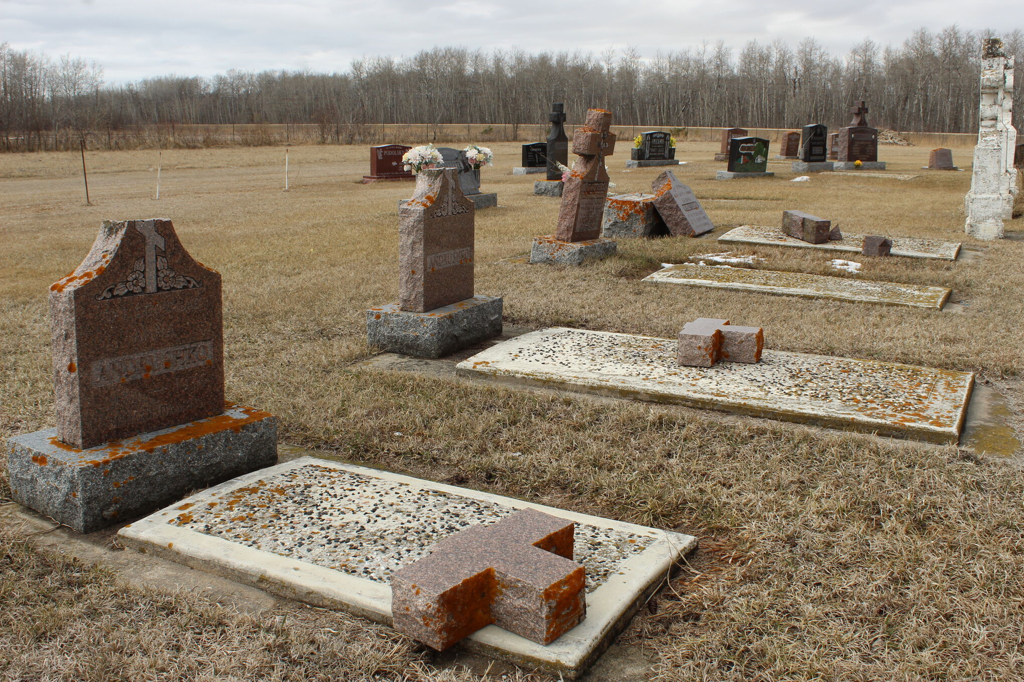 Gravestones lay broken in the Vita Ukrainian Catholic-Orthodox Cemetery, which was targeted by vandals earlier this month.