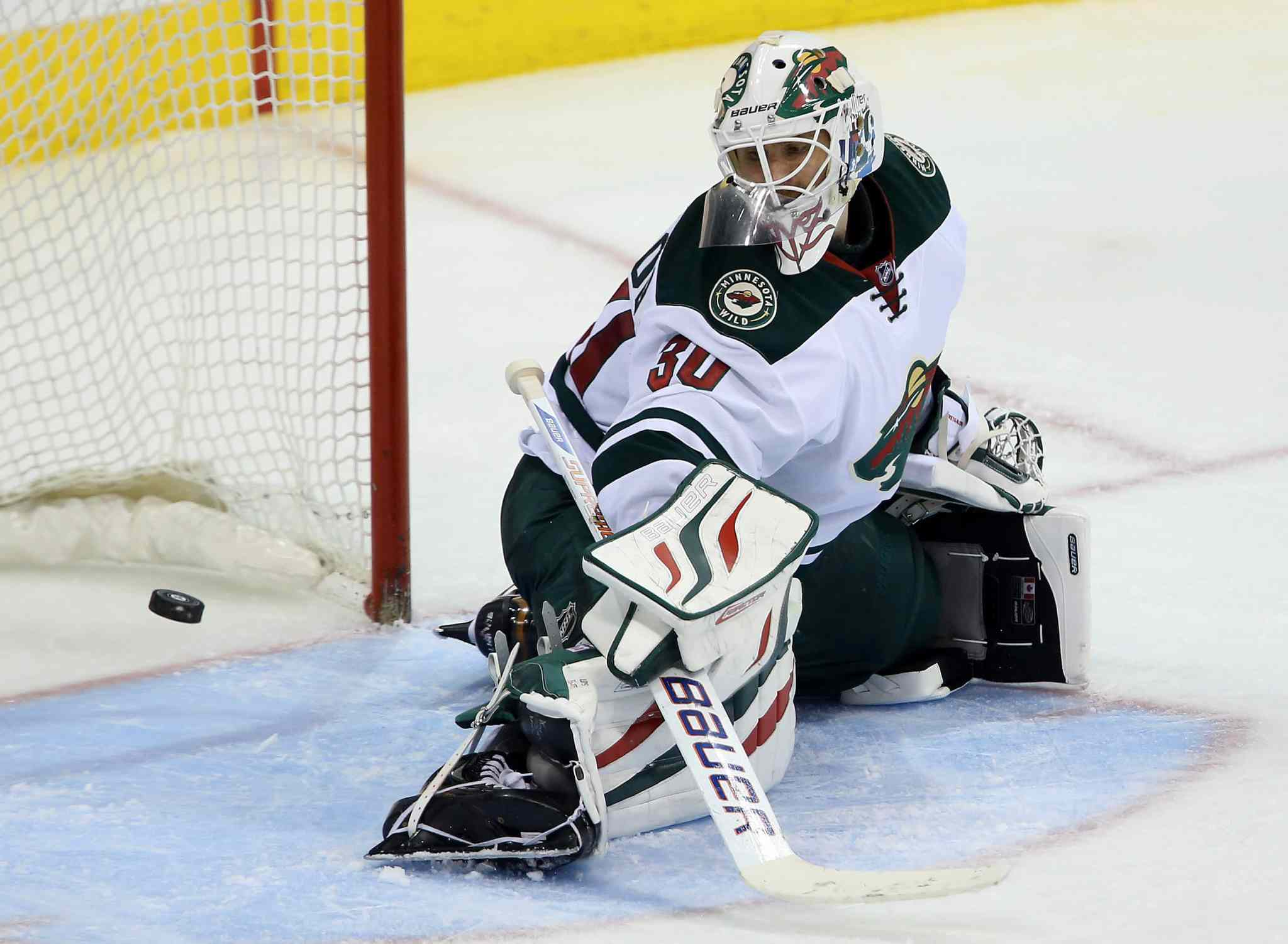 Wild goaltender Ilya Bryzgalov makes a pad save during the third period.