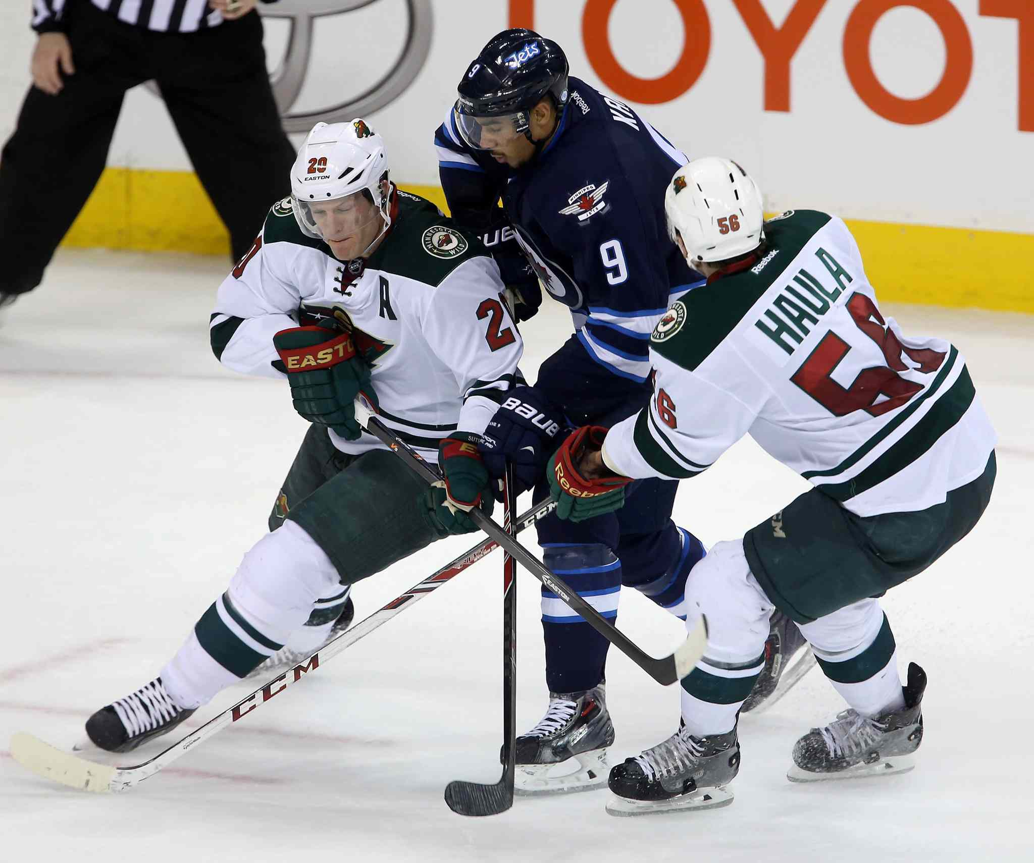 The Minnesota Wild's Ryan Suter (20) and Erik Haula sandwich Jets forward Evander Kane during third-period play.