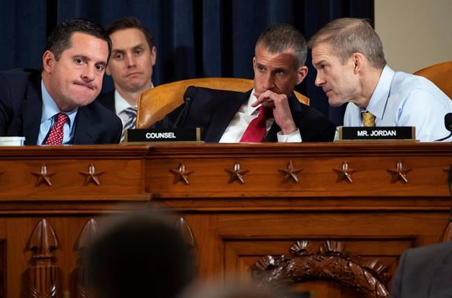 Ranking member Rep. Devin Nunes, R-Calif., left, confers with Rep. Jim Jordan, R-Ohio, right, and Steve Castor, Republican staff of the House Oversight Committee, as top U.S. diplomat in Ukraine William Taylor, and career Foreign Service officer George Kent, testify before the House Intelligence Committee on Capitol Hill in Washington, Wednesday, Nov. 13, 2019, during the first public impeachment hearing of President Donald Trump's efforts to tie U.S. aid for Ukraine to investigations of his political opponents. (Saul Loeb/Pool Photo via AP)