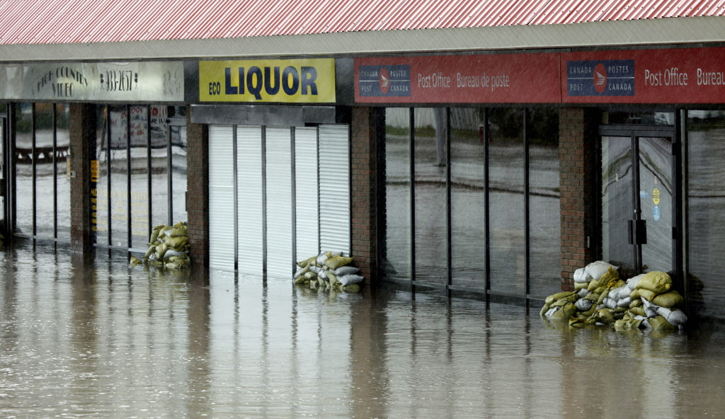 Flooded stores in Black Diamond, Alta. (Jeff McIntosh / The Canadian Press)