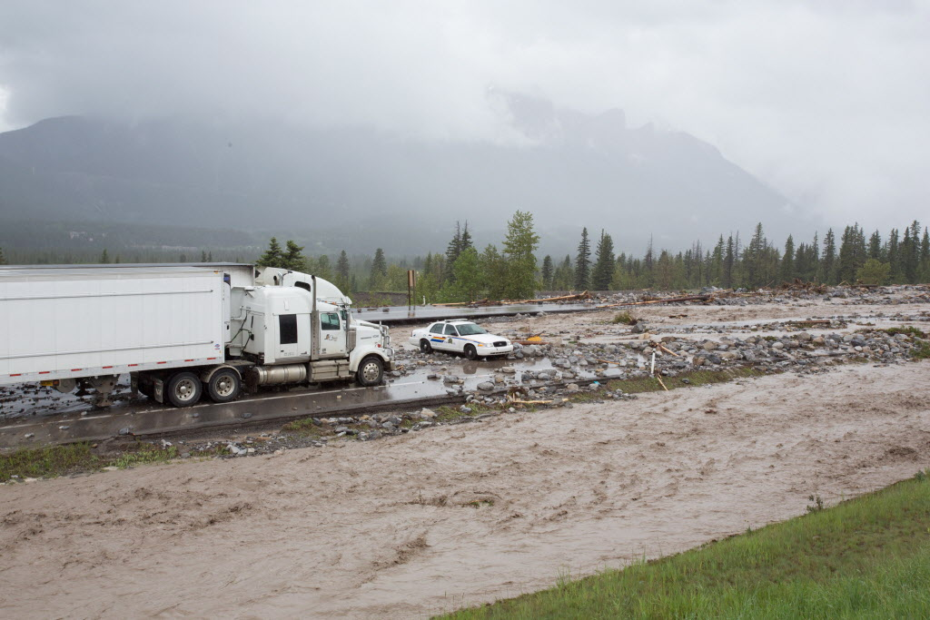 An RCMP cruiser blocks access to the Trans-Canada Highway in Canmore, Alta. (John Marriott / The Canadian Press)