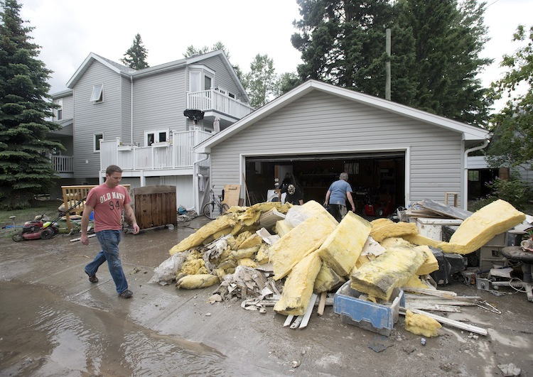 The community of Bowness in Calgary continues with the clean-up Monday. (Nathan Denette / The Canadian Press)