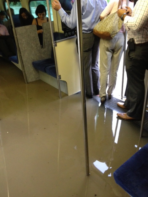 The water began rising inside the GO Train not long after it hit the flooded tracks. (Michael Li / The Canadian Press)