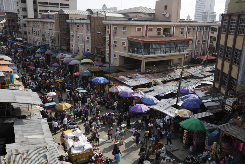Pedestrians shop for wares in a market in Lagos, Nigeria, Thursday. (Sunday Alamba / The Associated Press )