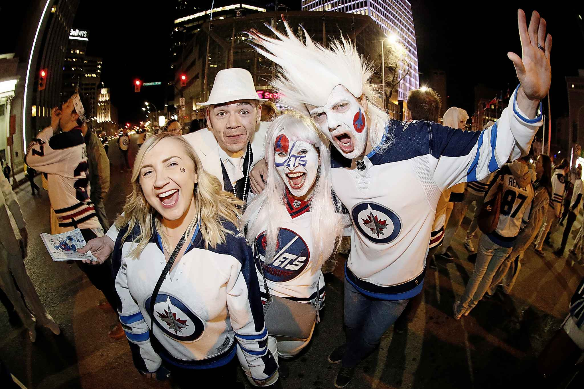 Winnipeg Jet fans celebrate at Portage and Main in downtown Winnipeg after the Winnipeg Jets defeated the Minnesota Wild in game five of their NHL playoff series to win the first round 4-1 in Winnipeg on last April.