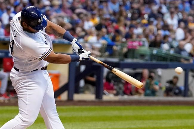 Milwaukee Brewers' Jesus Aguilar hits a double during the fourth inning of a baseball game against the Cincinnati Reds Monday, July 22, 2019, in Milwaukee. (AP Photo/Morry Gash)