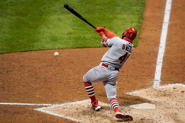 St. Louis Cardinals' Tyler O'Neill hits an RBI single during the fifth inning of the second game of a baseball doubleheader against the Milwaukee Brewers Monday, Sept. 14, 2020, in Milwaukee. (AP Photo/Morry Gash)
