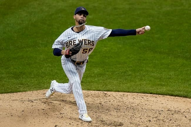 Milwaukee Brewers relief pitcher Alex Claudio throws during the fifth inning of the second game of a baseball doubleheader against the St. Louis Cardinals Monday, Sept. 14, 2020, in Milwaukee. (AP Photo/Morry Gash)