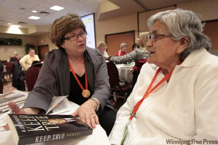 Manitoba's Finance Minister Rosann Wowchuk talks to Louise Mercredi, a delegate from Grand Rapids while at the NDP's annual convention on Saturday.
