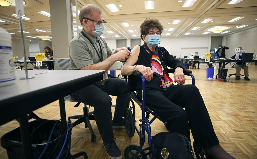 Gisella Greschner, 97, receives her COVID-19 vaccination at the convention centre in Winnipeg, one of three of the province's so-called supersites. (Kevin King / Pool files)