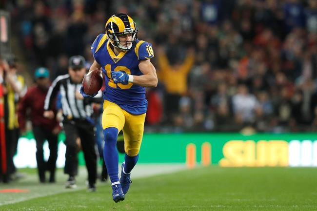 Los Angeles Rams wide receiver Cooper Kupp (18) runs against the Cincinnati Bengals during the first half of an NFL football game, Sunday, Oct. 27, 2019, at Wembley Stadium in London. (AP Photo/Frank Augstein)