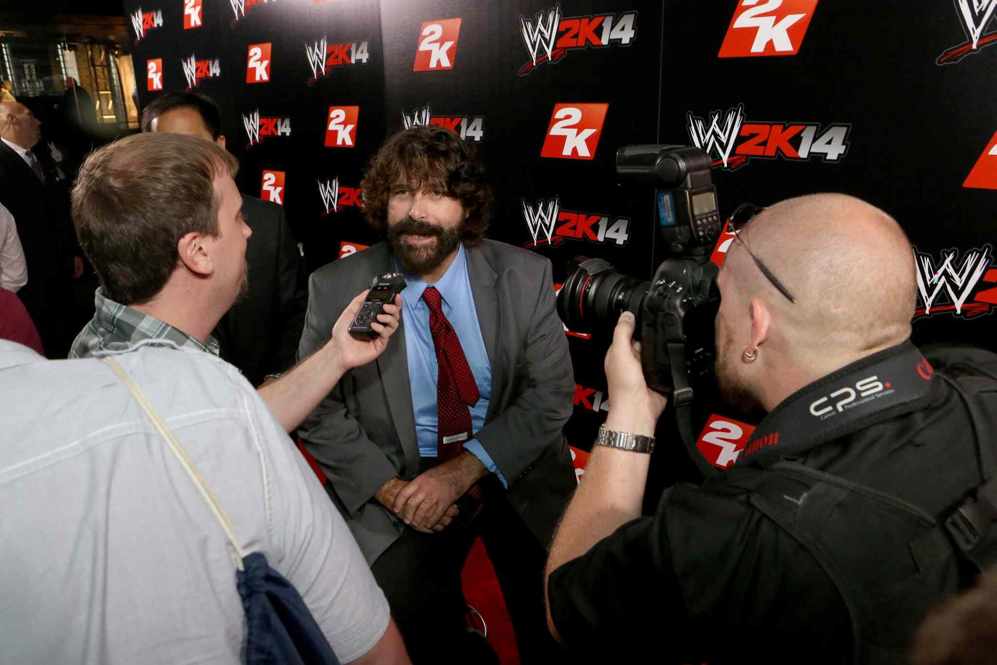 WWE Hall of Famer Mick Foley talks with media at the WWE 2K14 press event in August 2013.