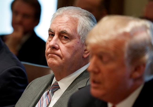 FILE - In this Jan. 10, 2018 file photo, Secretary of State Rex Tillerson listens as President Donald Trump speaks during a cabinet meeting at the White House in Washington. Tillerson is out as secretary of state. President Trump tweeted this morning that he's naming CIA director Mike Pompeo to replace him. (AP Photo/Evan Vucci)