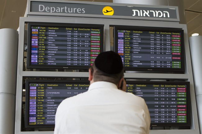 A departure flight board displays various canceled and delayed flights in Ben Gurion International airport in Tel Aviv, Israel, Wednesday, July 23, 2014, after the U.S. Federal Aviation Administration imposed a 24-hour restriction on flights after a Hamas rocket landed within a mile of the airport. Aviation has suffered one of its worst weeks in memory, a cluster of disasters spanning three continents. (AP Photo/Dan Balilty)