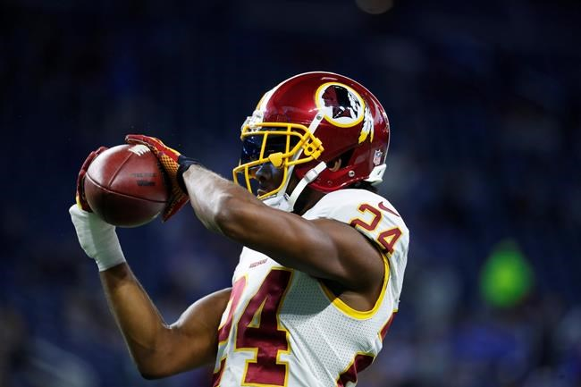 Redskins CB Norman, TE Reed cleared to travel to London