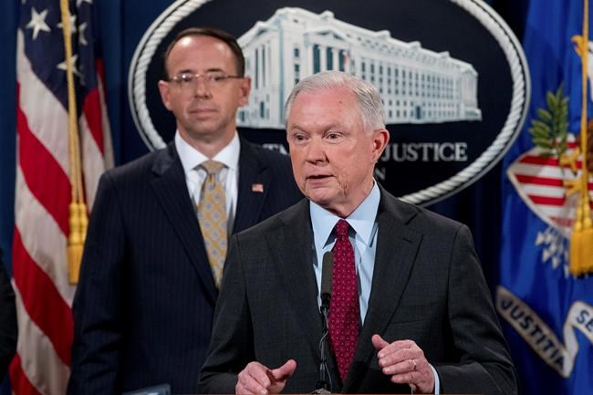 FILE - In this July 20, 2017 file photo, Attorney General Jeff Sessions accompanied by Deputy Attorney General Rod Rosenstein, speaks at a news conference at the Justice Department in Washington. Sessions resigned Nov. 7, 2018. as the country's chief law enforcement officer after enduring more than a year of blistering and personal attacks from President Donald Trump over his recusal from the Russia investigation. (AP Photo/Andrew Harnik)