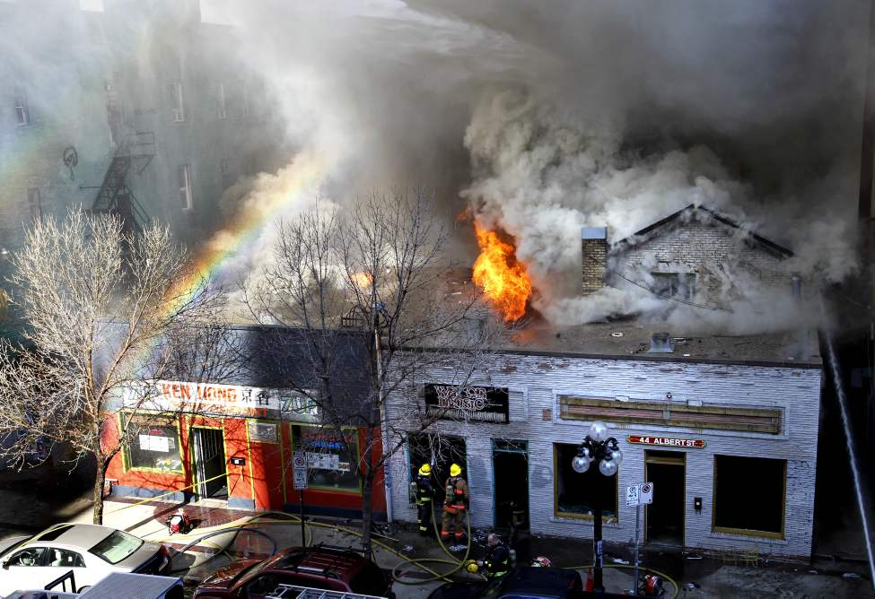 A fire at War on Music at 44 Albert Street and the Ken Hong Restaurant in the Exchange District spreads smoke over the downtown area.  Thursday, April 19, 2012. (WAYNE GLOWACKI / WINNIPEG FREE PRESS)