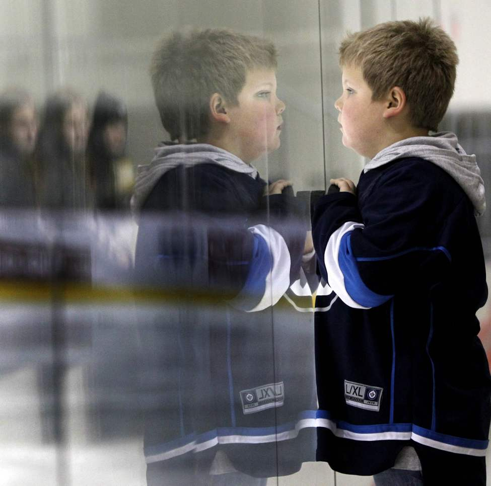 Six-year-old Ayden Munro watches some players from his favourite team, the Winnipeg Jets, practice at the MTS Iceplex as the lockout continues.  Friday, November 16, 2012. (WAYNE GLOWACKI / WINNIPEG FREE PRESS)