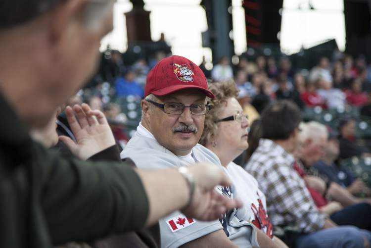 Wayne Basso (left) and wife Darleen McDougall take in a game at Haymarket Park.