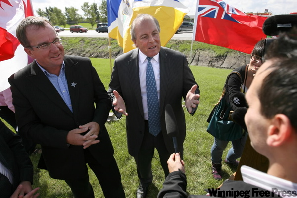 Manitoba Minister of Transportation Ron Lemieux (right) along with Winnipeg Deputy Mayor Justin Swandel talk to the media about Kenaston Boulevard plans.