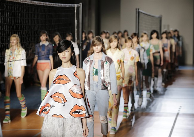 Models wear creations for Au Jour Le Jour women's Spring Summer 2015 collection, part of the Milan Fashion Week, unveiled in Milan, Italy, Sunday, Sept. 21, 2014. (AP Photo/Antonio Calanni)