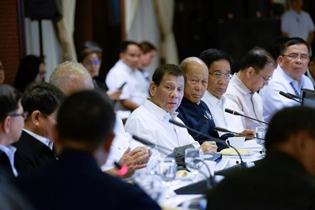 In this Tuesday, Jan. 7, 2020, photo provided by the Malacanang Presidential Photographers Division, Philippine President Rodrigo Duterte, center, presides during the Joint Armed Forces of the Philippines-Philippine National Police (AFP-PNP) Command Conference at the Malacanang presidential palace in Manila, Philippines. The Philippine government has ordered the mandatory evacuation of Filipino workers from Iraq and is sending a coast guard vessel to the Middle East to rapidly ferry its citizens to safety in case hostilities between the United States and Iran worsen, officials said Wednesday. (King Rodriguez/Malacanang Presidential Photographers Division via AP)