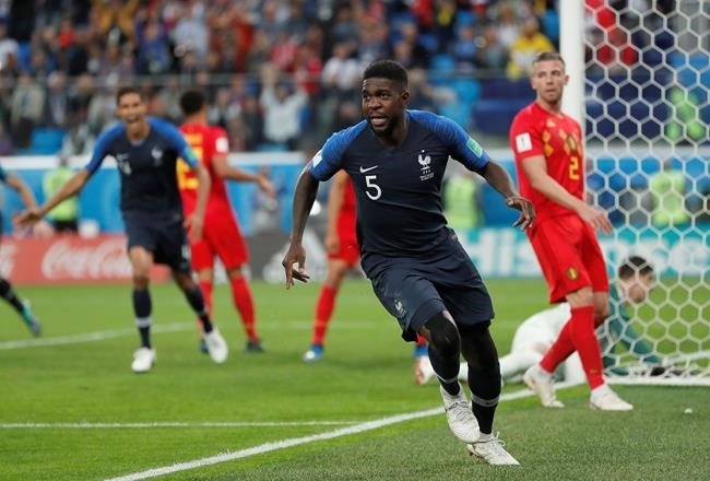 France's Samuel Umtiti celebrates after scoring his sides 1st goal of the game during the semifinal match between France and Belgium at the 2018 soccer World Cup in the St. Petersburg Stadium in, St. Petersburg, Russia, Tuesday.