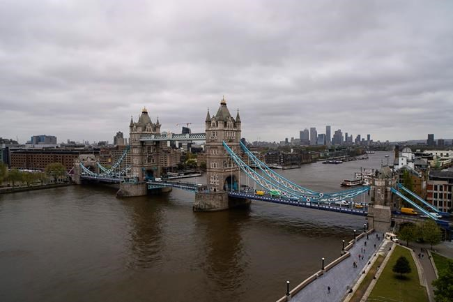 Tower Bridge in London, Saturday, May 8, 2021, against the backdrop of the skyline of the financial district. On what was dubbed Super Thursday, around 50 million voters were eligible to take part in scores of elections in the UK, some of which had been postponed a year because of the pandemic that has left the U.K. with Europe's largest coronavirus death toll. (AP Photo/Alberto Pezzali)