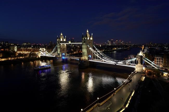 General view of the Tower Bridge, against the backdrop of the skyline of the financial district of Canary Wharf, in London, Saturday, May 8, 2021. Millions of people across Britain have voted on Thursday, in local elections, the biggest set of votes since the 2019 general election. (AP Photo/Alberto Pezzali)