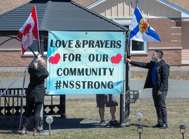 Workers at an extended care facility show their community support in Debert, N.S. on Tuesday, April 21, 2020. RCMP say at least 19 people are dead after a man who at one point wore a police uniform and drove a mock-up cruiser, went a murder rampage in Portapique, and other Nova Scotia communities. The alleged killer was shot and killed by police. THE CANADIAN PRESS/Andrew Vaughan