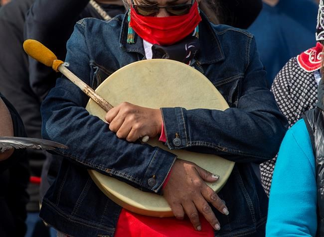 A Mi'kmaq drummer pauses during a prayer as members of the Sipekne'katik First Nation bless the fleet before it launches its own self-regulated fishery on the wharf in Saulnierville, N.S., on Thursday, Sept. 17, 2020. Two federal ministers have confirmed Indigenous fishermen have the right to fish to earn a living after meeting with Mi'kmaq chiefs in Nova Scotia on Monday.THE CANADIAN PRESS/Andrew Vaughan